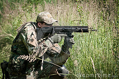 Special forces soldier aiming on enemy