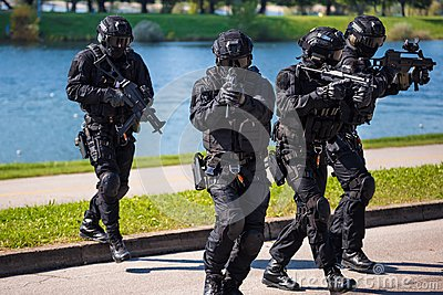 Special forces tactical team of four in action Stock Photo
