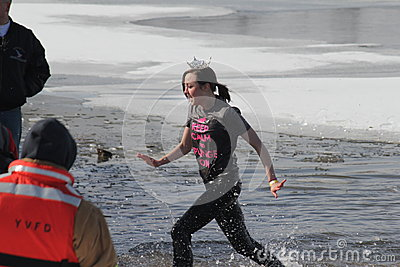 Special Olympics Nebraska Polar Plunge Miss Nebraska Contestant leaving the water Editorial Stock Image