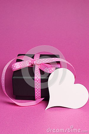 Free Special Small Black Box Present Gift With Pink Polka Dot Ribbon And White Heart Shape Gift Tag - Vertical With Copy Space. Royalty Free Stock Photography - 30399317