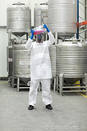 Specialist examining liquid in plastic container