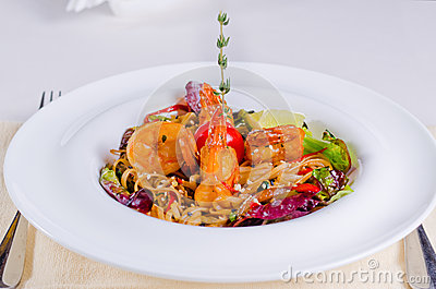 Speciality pasta recipe with grilled shrimps or prawns, fresh herbs ...