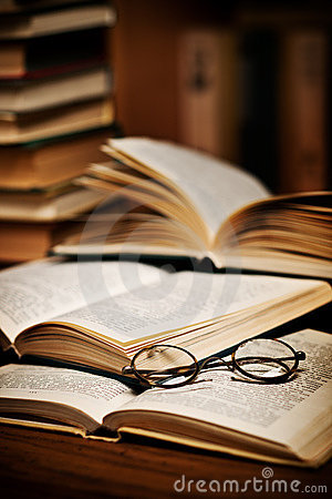 Spectacles on open books