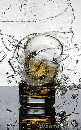 Free Spectacular High Speed Shot Of Whiskey Glasees Breaking Stock Images - 103878914