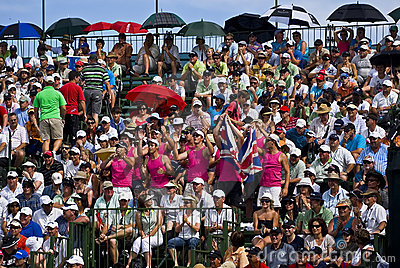 Spectators Pack the Pavilion - 18th Green Editorial Stock Image