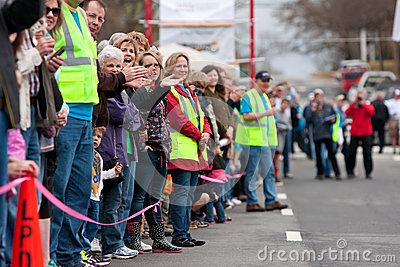Spectators Cheer Oncoming Participants In Small Town Race