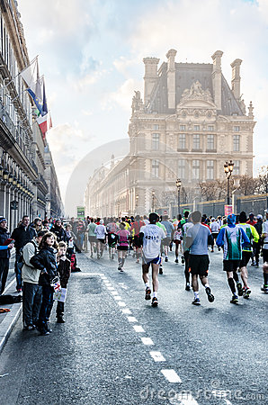 Spectators and participants of the annual Paris Marathon on the Editorial Stock Photo