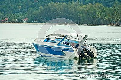 Speed boat on blue water