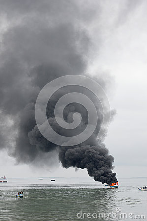 Speed boat on fire in Tarakan, Indonesia Editorial Stock Photo