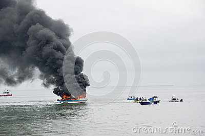 Speed boat on fire in Tarakan, Indonesia Editorial Stock Photo