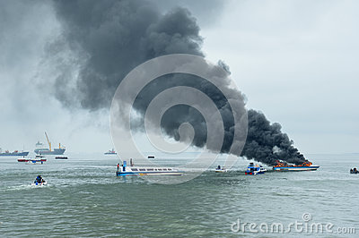 Speed boat on fire in Tarakan, Indonesia Editorial Photo