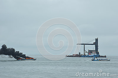 Speed boat on fire in Tarakan, Indonesia Editorial Stock Image