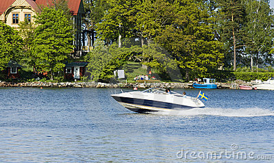 Speed-boat and island