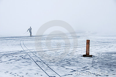 Speed skating on melting ice in winter fog