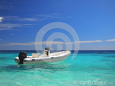 Speedboat in an emerald sea