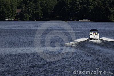 Speeding boat on a lake