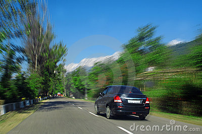 Speeding Car Blur snowpeaked himalaya road India