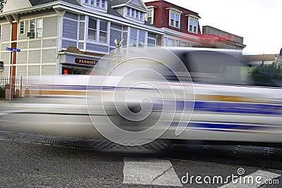 SPEEDING POLICE CAR. MOTION BLUR
