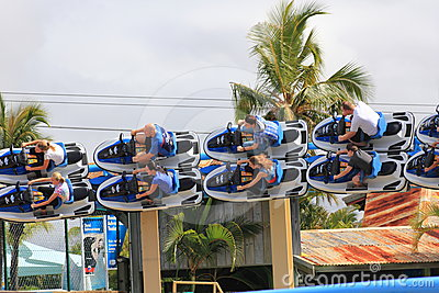 Speeding roller coaster ride in banked turn Editorial Photography