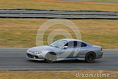 Speeding sports car in race