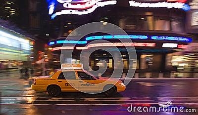 Speeding taxi Editorial Stock Image