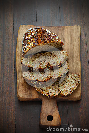 Free Spelt Flour Bread, Sliced On A Cutting Board For Breakfast Royalty Free Stock Photos - 31877848