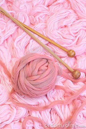 Sphere of pink wool with needles