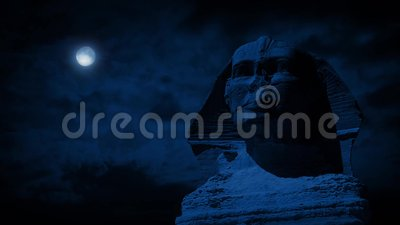 The Sphinx Statue At Night With Moon. Closeup of the Sphinx in Egypt illuminated by a bright full moon above