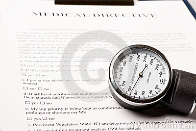 Sphygmomanometer on medical directive document