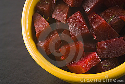 Spiced beet salad in yellow bowl