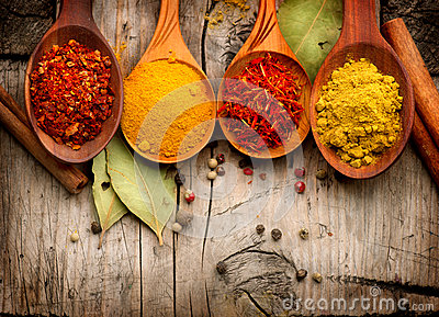 Spices and herbs over wood