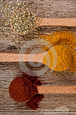 Spices in wooden spoons