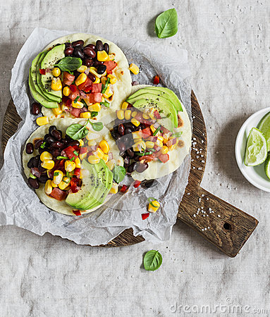 Free Spicy Bean Tacos With Corn Salsa And Avocado  On A Rustic Cutting Board On A Dark Background. Royalty Free Stock Photo - 84323605