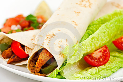 Spicy mexican fajita wraps on a white background