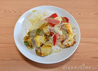 Spicy Salad With Fried Egg And Chicken Curry Stock Photo - Image ...