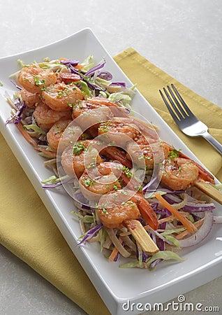 Free Spicy Shrimp Skewers On Coleslaw Salad Stock Image - 26228791