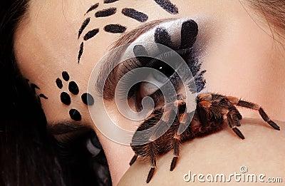 Spider-girl with spider Brachypelma smithi
