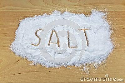 Spilled Salt On A Wooden Table