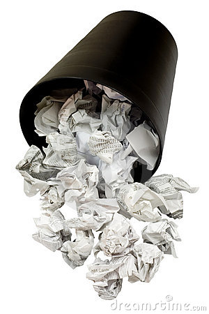 Spilled wastepaper basket full of crumpled paper