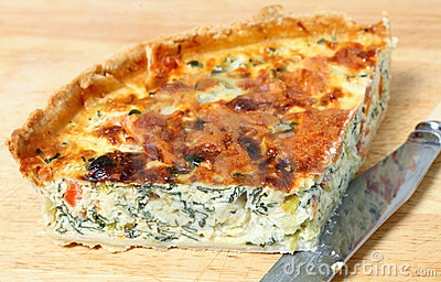Spinach quiche on a board