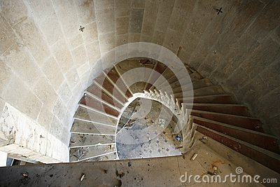 Spiral staircase in an abandoned hotel
