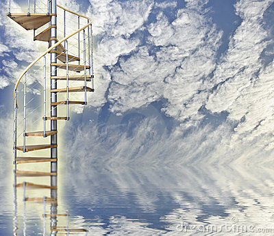 Spiral stairway to heaven glows against blue sky
