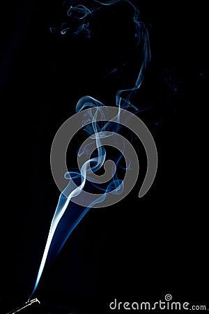Spiraling smoke abstract on black