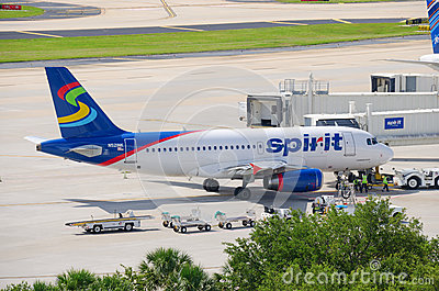 Spirit Airlines plane at airport boarding bridge Editorial Stock Photo