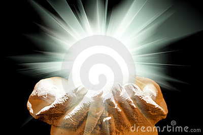 Spiritual light in cupped hands