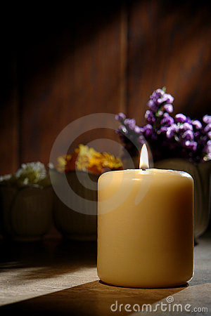 Spiritual Reflection Pillar Candle Softly Burning