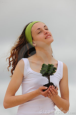 Spiritual woman planting a flower
