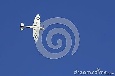 Spitfire against deep blue sky