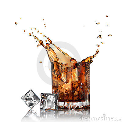 Splash of cola in glass with ice cubes isolated