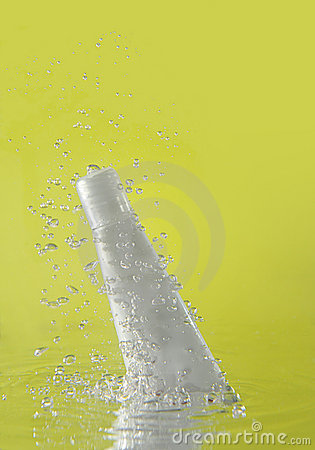 Splash of cosmetic bottle falling in water